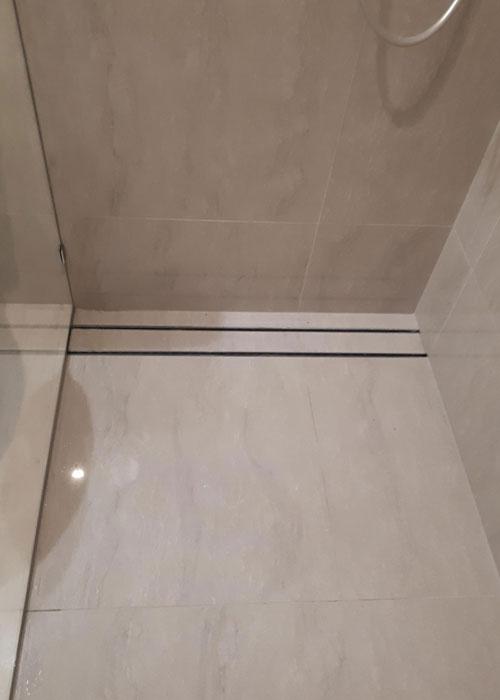 Long thin floor waste